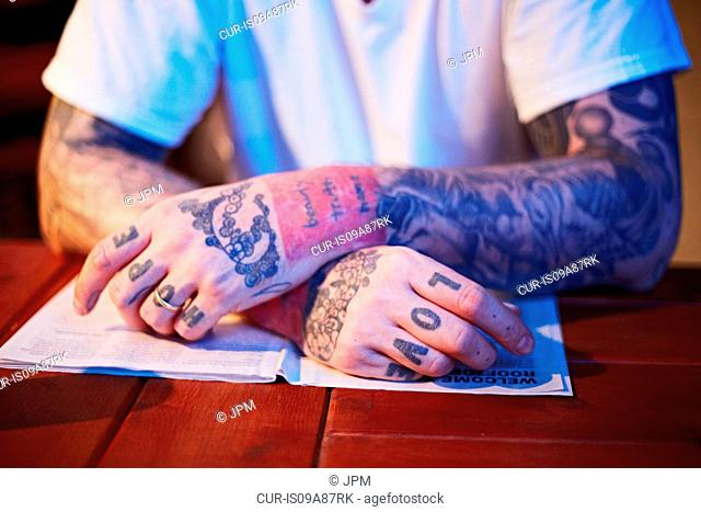 Man with the words Hope and Love tattooed on hands