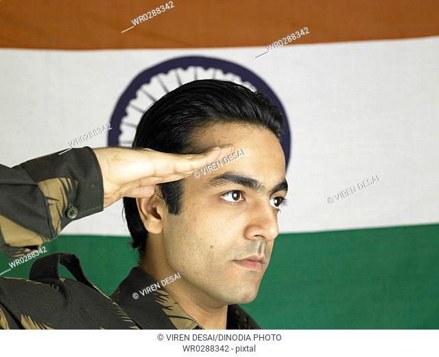 Indian army soldier saluting flag of India in background MR702A