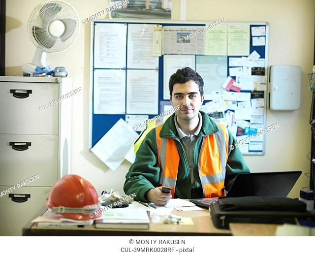 Construction worker sitting in office