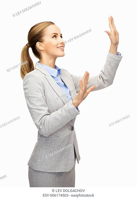 business and future technology concept - smiling businesswoman pointing to something or pressing imaginary button