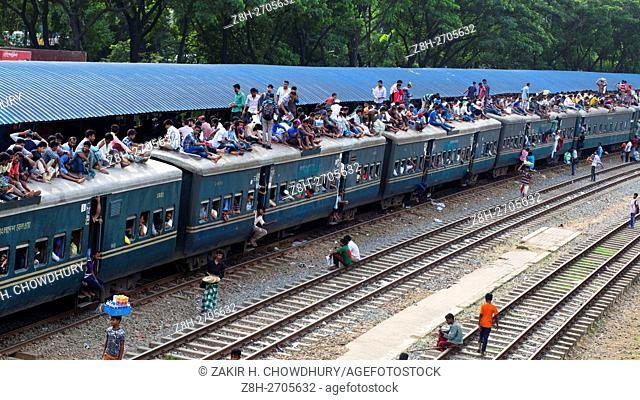 DHAKA, BANGLADESH - JUNE 30 :Bangladeshi people board on overcrowded train travelling risky ride to their home villages in Dhaka, Bangladesh on June 30, 2016