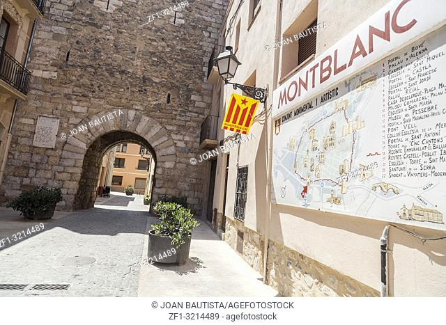 Sign name village, map and medieval door entrance to historic center of Montblanc, province Tarragona, Catalonia. Spain