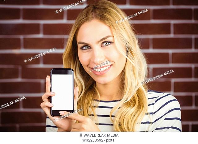 Woman holding her smartphone