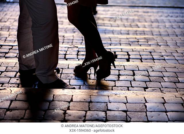 Couple in Rome standing on cobble stones