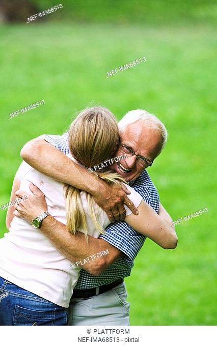 Woman and senior man embracing each other Sweden