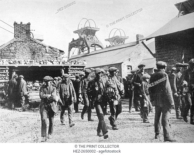 'Miners leaving the pithead after the expiration of their strike notices', 1915. Artist: Unknown