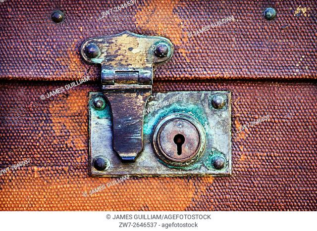 Vintage suitcase lock and fastener close up