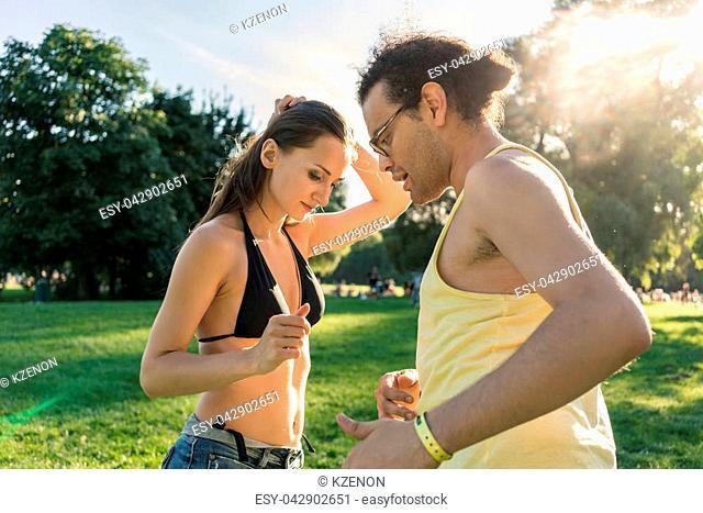 Dance couple training bachata in summer park