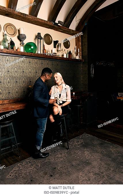 Couple in pub chatting