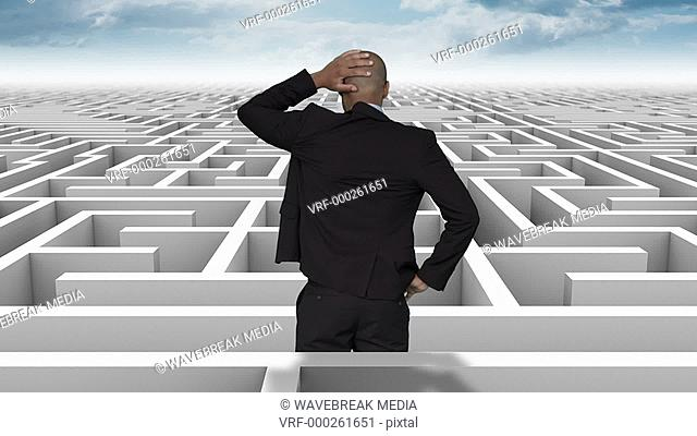 Businessman in a difficult maze