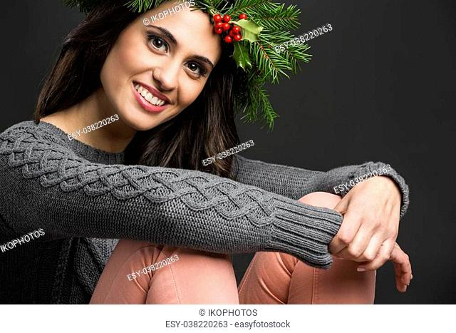 Portrait of a beautiful woman with Cristmas decorations on the head