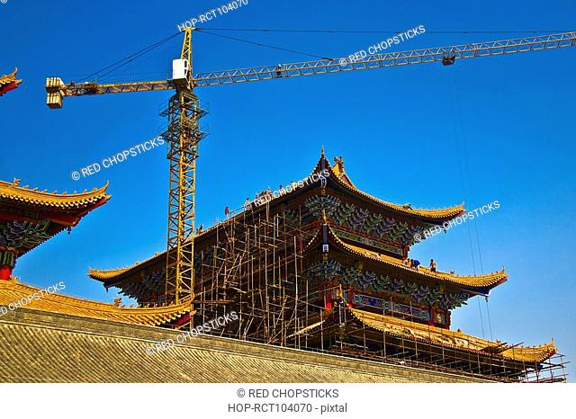 Low angle view of a crane at a construction site, HohHot, Inner Mongolia, China