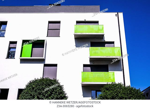 Modern apartment building with green balconies, Brussels, Belgium, Europe