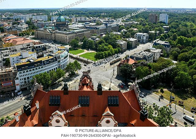 25 July 2019, Saxony, Leipzig: Panoramic view from the tower of the New Town Hall to the city centre of Leipzig in southwest direction with the New Town Hall...
