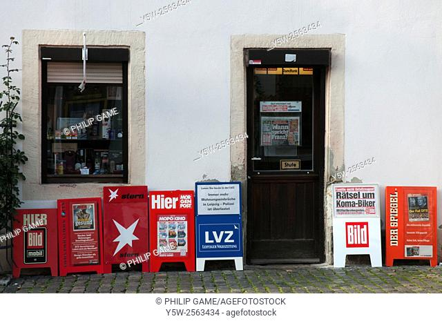 Newspaper vending boxes in the small town of Colditz, Germany