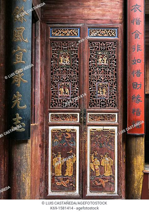 Carved wood door in an old house in Hongcun City