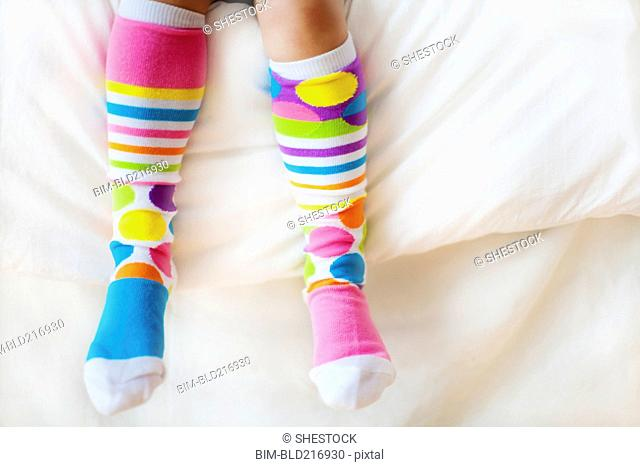 Close up of child wearing colorful socks