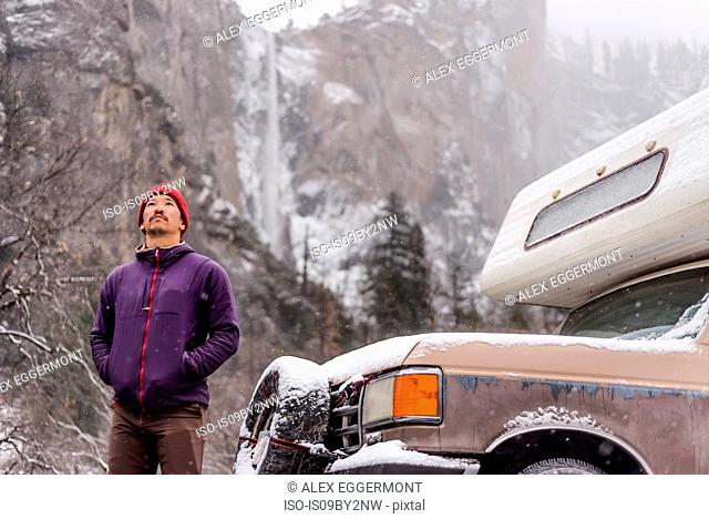 Climber in front of campervan, Yosemite National Park, California, USA