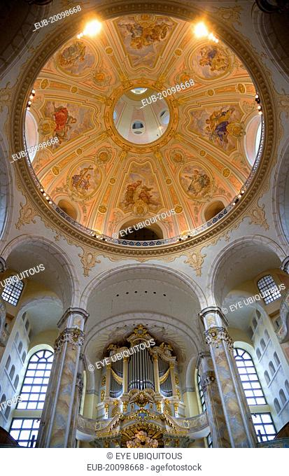 Interior of the restored Frauenkirche Church of Our Lady showing the central dome with murals and the organ