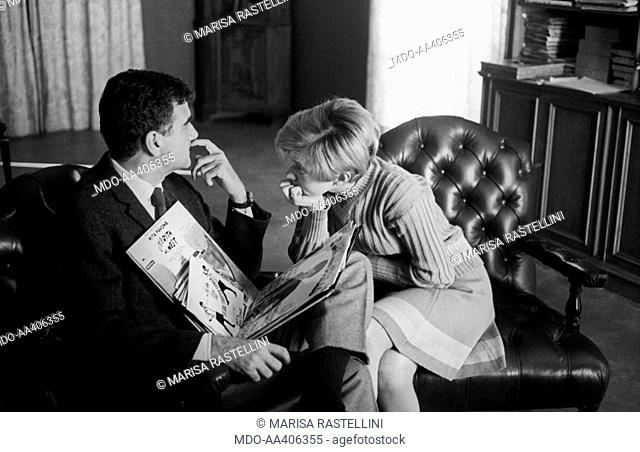 Rita Pavone looking at Teddy Reno. Some vinyl records resting on Italian singer Teddy Reno (Ferruccio Merk Ricordi). Italian-born Swiss singer and actress Rita...