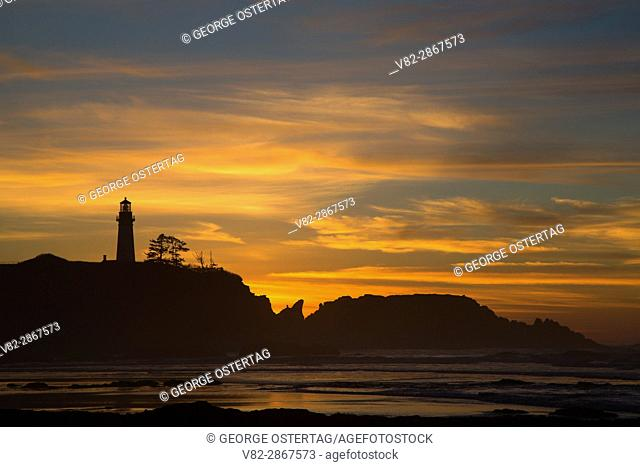 Yaquina Head Lighthouse sunset from Moolack Beach, Newport, Oregon