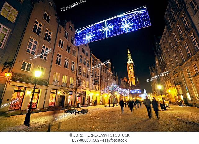 Christmas decoration at Dluga street, The Belltower of Town Hall is in the background, Gdansk, Pomeranian, Poland, Europe