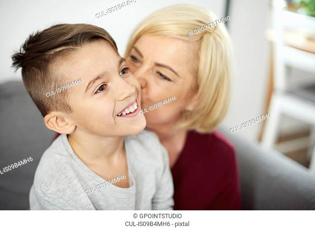 Grandmother kissing grandson's cheek