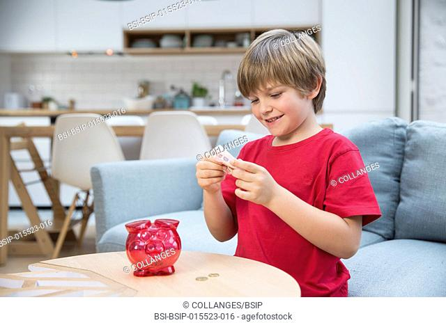 A child counting his pocket money