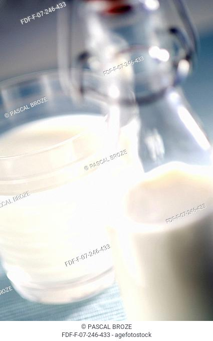 Close-up of a milk bottle and a glass of milk