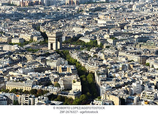 The Arc de Triomphe monument seen from the top floor of the Eiffel Tower, surrounded by city and connecting streets, Paris, France