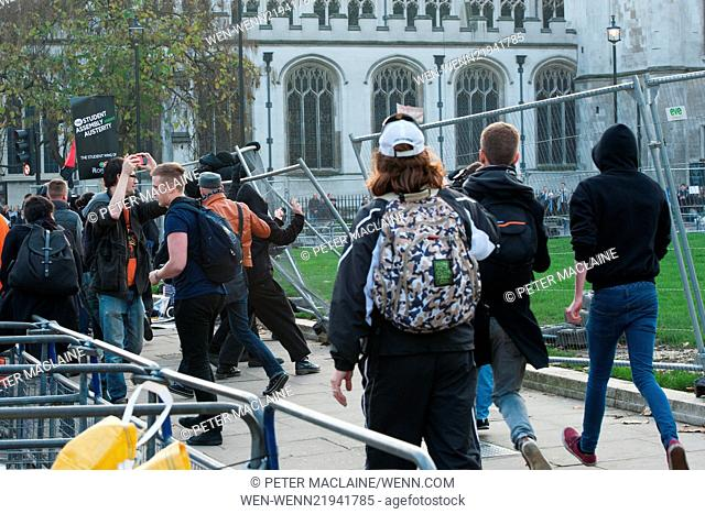 Students clash with police during the Free Education protest organised by the National Campaign Against Fees and Cuts (NCAFC)