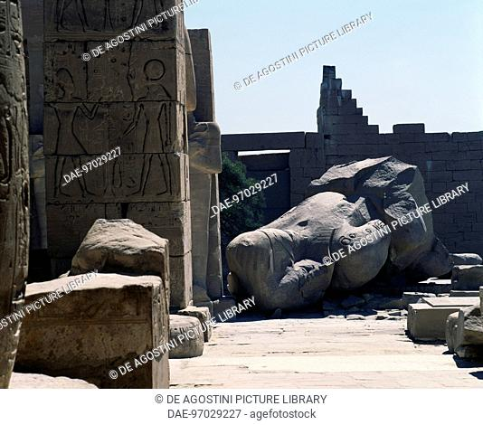 The remains of the Colossus of Ramesses II, statue in syenite (red granite), first courtyard ofthe Ramesseum (funerary temple of Ramses II)