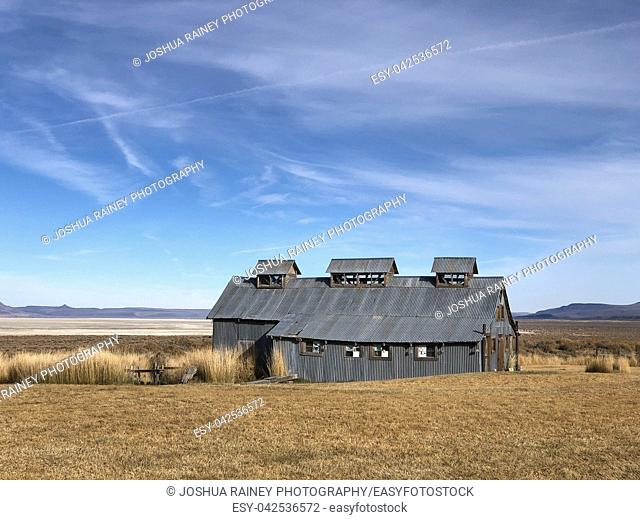 Steel barn building covering the geothermal hot springs at Summer Lake in South Central Eastern Oregon