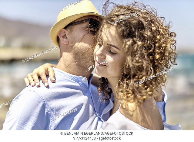woman enjoying seduction of man, at beach, holidays, summer
