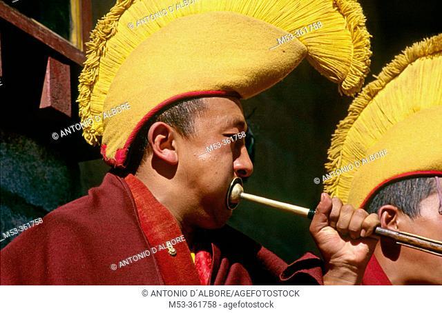 Monk play trumpet. Pangboche Gompa. Himalaya Region. Nepal