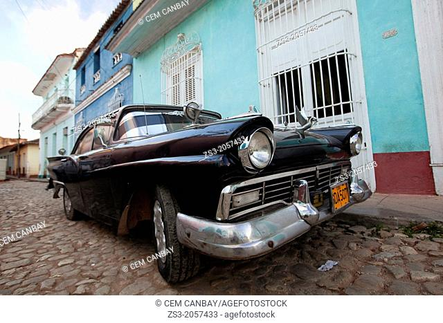 Old american car parked at the street side, Trinidad, Cuba, Central America