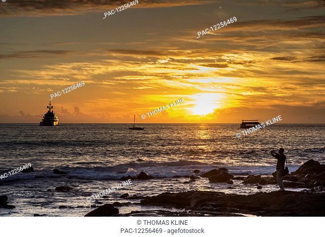 Super yacht Vava II at anchor in Kailua Bay at sunset; Kailua-Kona, Island of Hawaii, Hawaii, United States of America