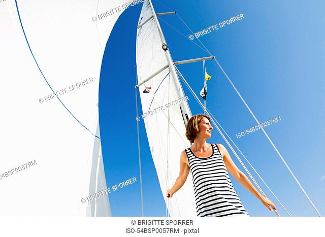 Woman walking on boat