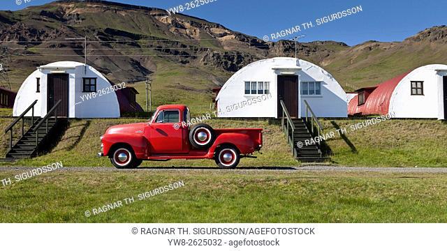 Old chevrolet pick up truck in front of old summer cabins, Hvalfjordur, Iceland