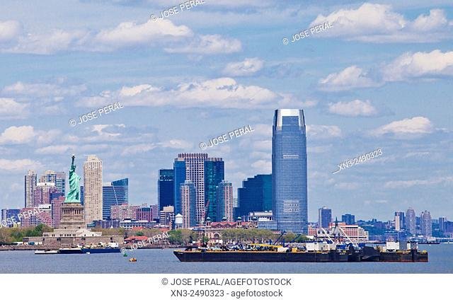 Statue of Liberty, New Jersey City at the back, New Jersey, New York, USA
