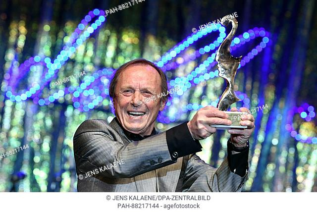 German actor Claus Theo Gaertner poses with his award at theItalian film ball 'Notte delle Stelle' held during the 67th International Berlin Film Festival