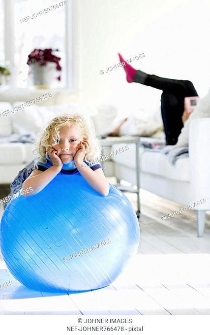 Girl playing with a big blue ball, Sweden
