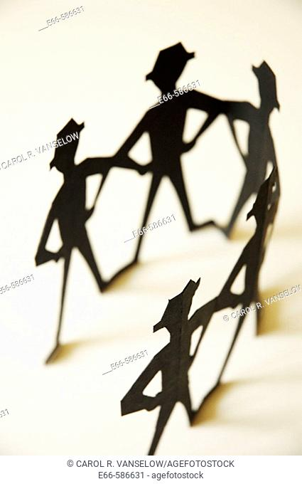 black cutout dolls on on off-white background. Black men in fedoras