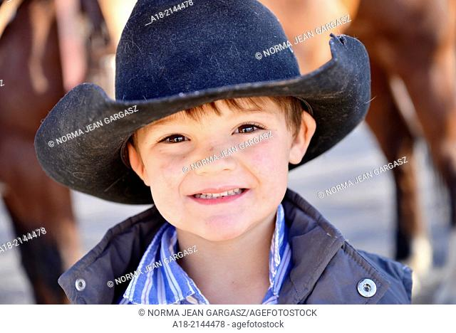 A 4-year-old cowboy smiles at the Tucson Rodeo Parade, the longest non-motorized parade in the nation. The 89-year-old event occurs each February in conjunction...