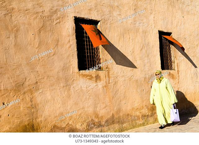 An old woman walking in the old city of Meknes