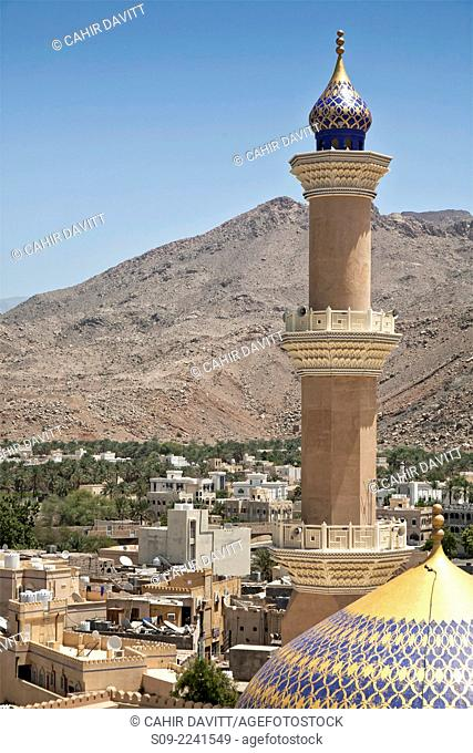 View from Nizwa Fort of the minaret of the As Sultan Qaboos Mosque with the Hajar Mountains in the background, Al Jinah, Nizwa, Ad Dakhiliyah Governorate, Oman