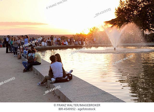 People enjoying the sunset at Debod Temple (Templo de Debod), Parque del Oeste, Madrid, Spain