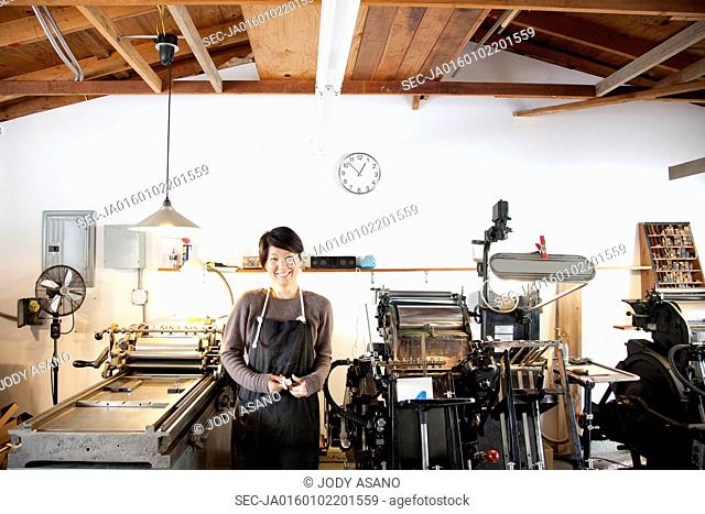 Smiling woman in workshop