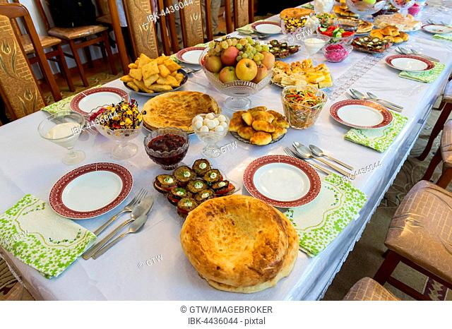 Table with food set for guests, Shymkent, South Region, Kazakhstan