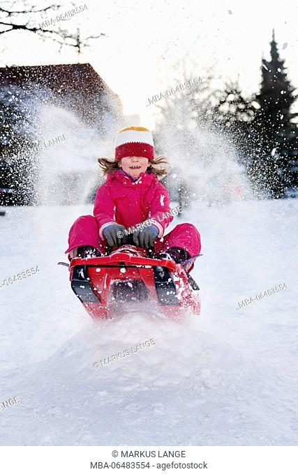 Girls sledding